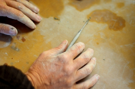 The Hands Of A Craftswoman On A Workbench photo