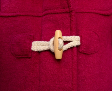 duffle: Toggle Button On A Red Duffle Coat