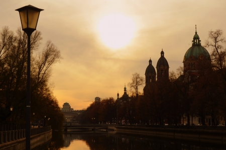 A Silhouette Of The Munich, Germany Skyline At Sunset photo