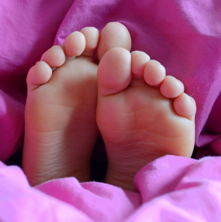 girl soles: Parenthood Image Of The Feet Of A Sleeping Child
