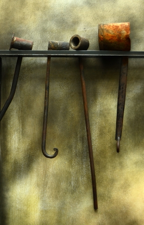 ancient blacksmith: Industrial Image Of Some Grungy Forge Tools