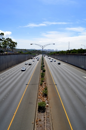 Cars On A Highway With Downtown In The Distance With Copy Space Stock Photo - 18096053