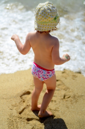 Soft Focus Lifestyle Image Of A Young Child Playing On A Sunny Beach photo