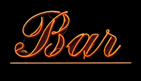 Grungy Isolated Neon Bar Sign Against Black Background photo