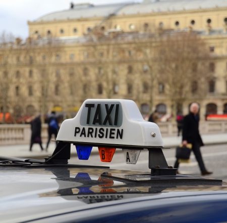 A Paris Taxi On A Bridge Over The River Seine With People In The Background Stock Photo - 18708040