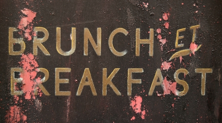culinary tourism: A Grungy French Brunch And Breakfast Sign Outside A Restaurant