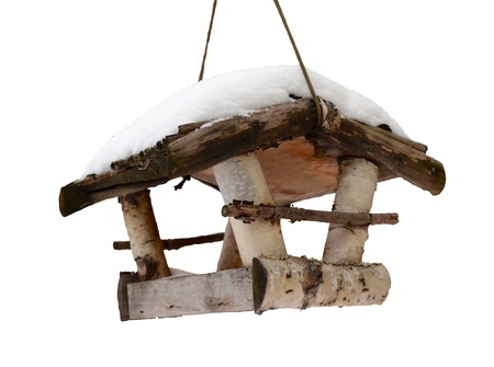 Seasonal Winter Isolation Of Snow Covered Bird House With Clipping Path photo