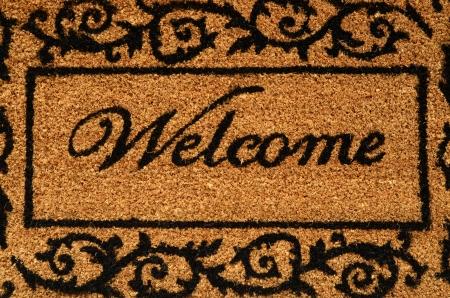 welcome door: Concettuale immagine di un tappetino di benvenuto del portello