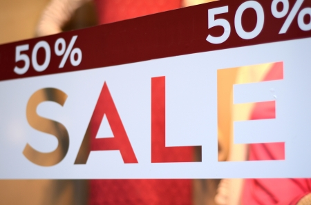 Retail Image Of A Sale Sign In A Clothing Store Window (With Shallow DoF)