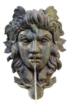 Isolation Of An Ornate Water Fountain With Mythological Face