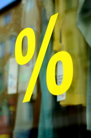 A Large Percentage Sign In A Clothing Store Window  With Shallow DoF  Stock Photo - 20879780