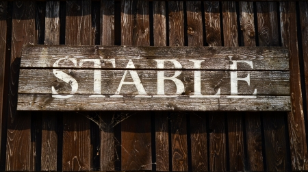 horse stable: Rustic Sign For A Stable On A Ranch In Western USA