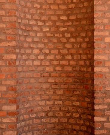 enclave: Architectural Feature Of A Curved Red Brick Wall For A Chimney