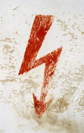 Grungy Red Electricity High Voltage Danger Sign photo