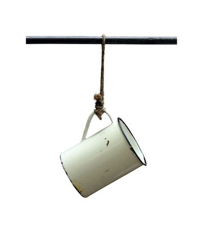 Isolation Of An Old Tin Camping Cup Hanging On A String