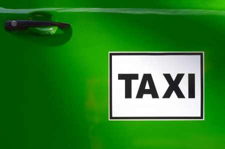 Sign On The Door Of A Bright Green Taxi Stock Photo - 21934731