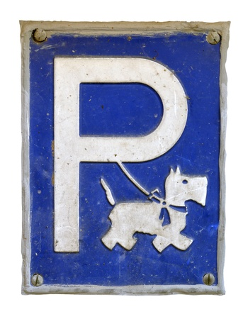bue: Isolation Of A Humorous And Grungy Dog Parking Sign Stock Photo
