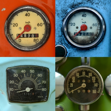 A Set Of Four Grungy, Vintage Odometers photo