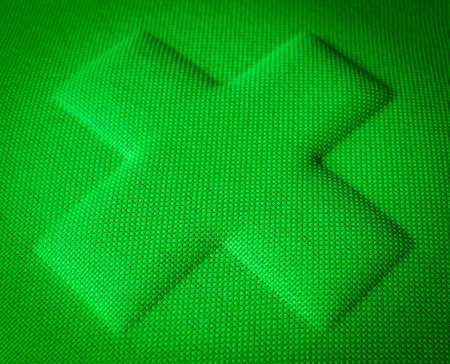 firstaid: A Green Cross Embossed In Fabric Stock Photo