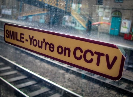 CCTV Sticker Sign On A Train Window In A Station photo