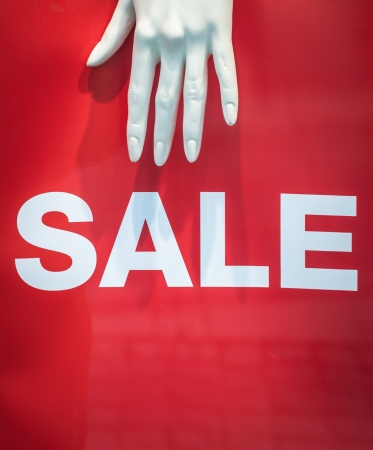 window display: A Mannequin Hand And Sale Sign Retail Store Display Stock Photo