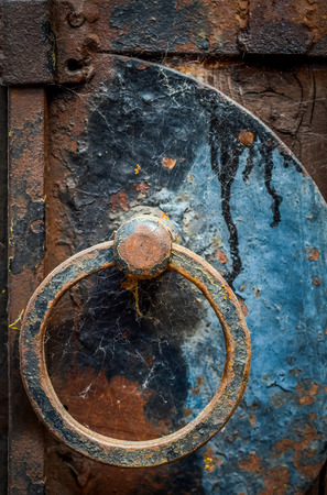 A Rustic Iron Door Handle With Cobwebs photo