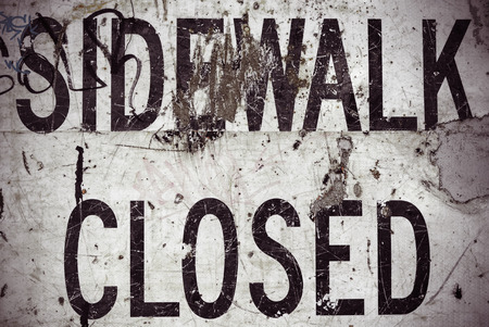 A Grungy Sidewalk Closed Sign From A USA Highway