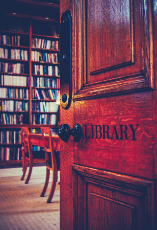 Retro Styled Image Of The Door To An Ancient Library photo