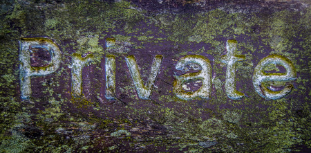 Grungy Wooden Private Sign With White Text And Lichen photo