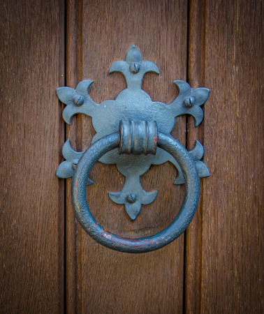 Ornamental Door Knocker On An Old Church Door photo