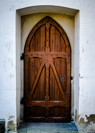 Detail Of A Rustic Wooden Church Or Chapel Door photo