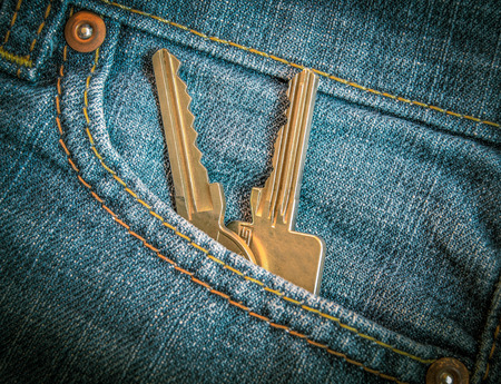 Retro FIltered Set Of Apartment Or Car Keys In Jeans Pocket photo