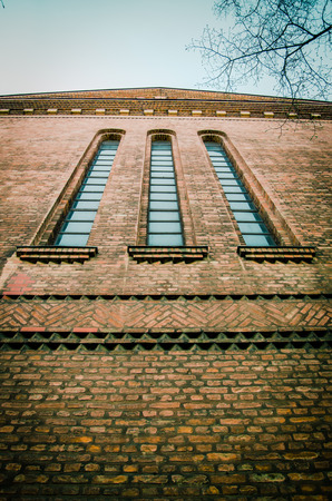 Retro Filtered View From Below Of Red Brick Church Tower Windows photo