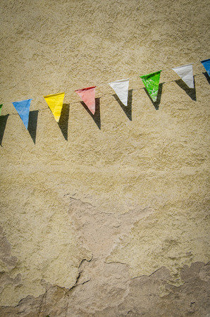 Grungy Retro Bunting Against An Old Building Wall photo