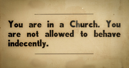 behave: Old VIntage Sign In A Church Asking Visitors To Behave Respectfully Stock Photo