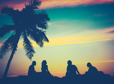 Retro Filtered Image Of Friends By The Beach in Hawaii photo