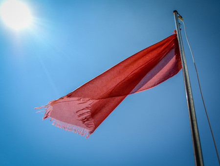Red Flag At A Beach Warning Of Dangerous Currents photo