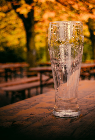 Retro Style Photo Of An Empty Beer Glass On A Beer Garden In Autumn Stock Photo