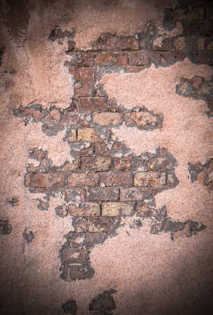 Grungy Background Texture Of Damaged Wall Revealling Brickwork photo