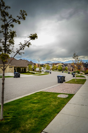 emptied: Stormy Skies Over An Emptied Average Suburban Street Stock Photo