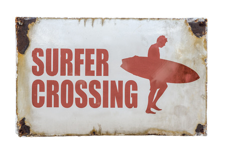 old sign: Grungy Retro Vintage Surfer Crossing Sign At A Road Crossing By A Beach