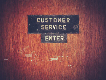public service: Grungy Customer Service Sign On Office Door Stock Photo