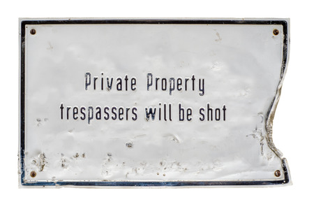 trespasser: Grungy Private Property Sign Stating That Trespassers Will Be Shot
