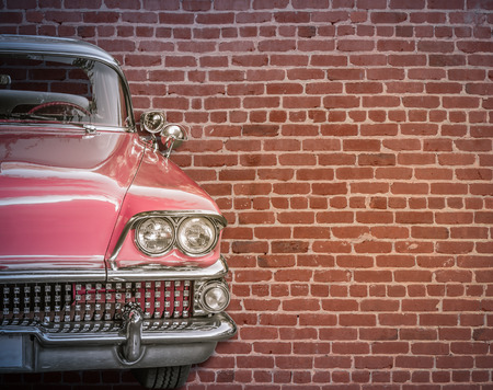 Classic Vintage 50s American Car Against A Red Brick Wall With Copy Spce 스톡 콘텐츠