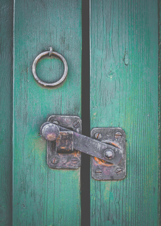 Retro Filtered Photo Of A Rustic Door Latch photo