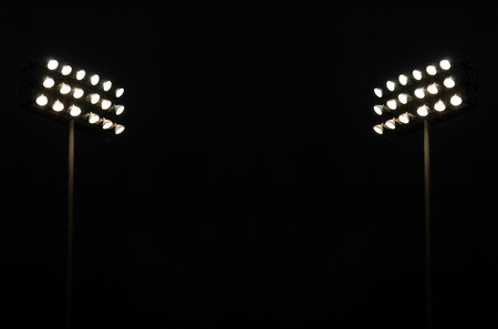 Twin Stadium Lights At A Sports Stadium At Night With Copy Space