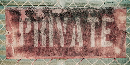 Retro Filtered Photo Of Rusty Grungy Old Private Property Sign On Chain Link Fence photo