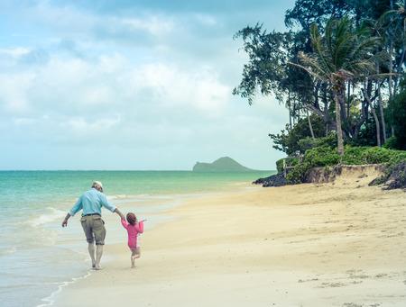 grandad: A Girl With Her Grandad On A Tropical Beach
