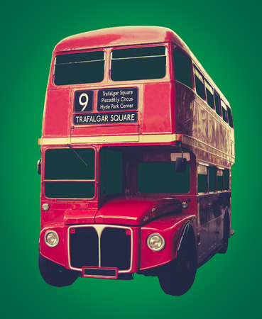 transport icon: Vintage Iconic Red London Bus On A Green Background