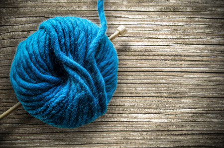 ball of wool: Retro Style Image Of A Ball Of Wool And Knitting Needle On A Rustic Wooden Table